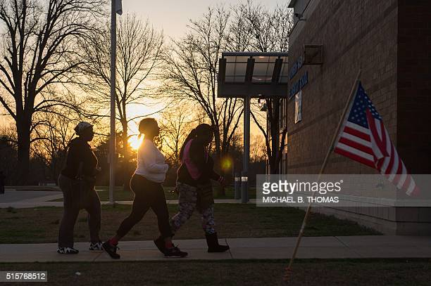 TOPSHOT Lastminute voters arrive to cast their vote during Missouri primary voting at JohnsonWabash Elementary School on March 15 2016 in Ferguson...