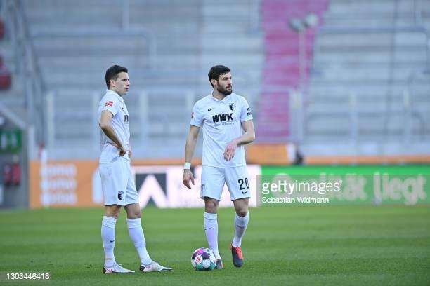 Laszlo Benes and Daniel Caligiuri of FC Augsburg prepare for a free kick during the Bundesliga match between FC Augsburg and Bayer 04 Leverkusen at...