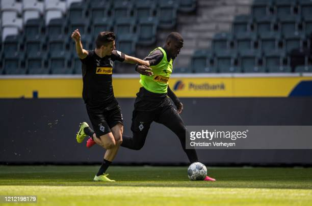 Laszlo Benes and Marcus Thuram battle for the ball during a training session of Borussia Moenchengladbach at BorussiaPark on May 08 2020 in...