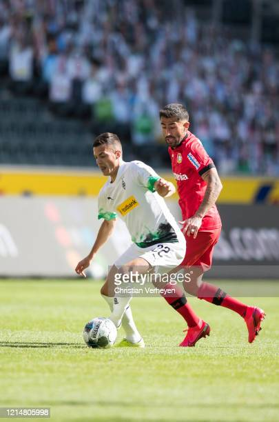 Laszlo Benes of Borussia Moenchengladbach and Kerem Demirbay of Bayer 04 Leverkusen battle for the ball during the Bundesliga match between Borussia...