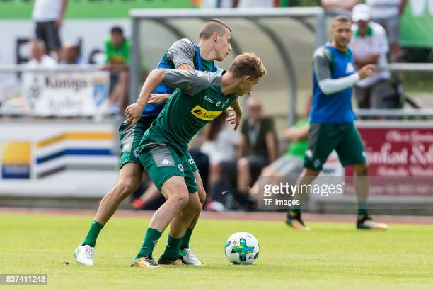 Laszlo Benes of Borussia Moenchengladbach and Mickaael Cuisance of Borussia Moenchengladbach battle for the ball during a training session at the...