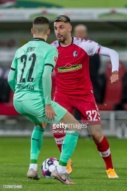Laszlo Benes of Borussia Moenchengladbach and Vincenzo Grifo of SC Freiburg battle for the ball during the Bundesliga match between Sport-Club...