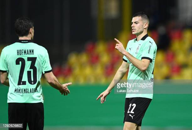 Laszlo Benes of Borussia Monchengladbach celebrates with teammate Jonas Hofmann after scoring their team's second goal during the DFB Cup second...