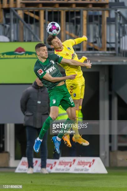 Laszlo Benes of FC Augsburg and Lukas Kuebler of SC Freiburg battle for the ball during the Bundesliga match between Sport-Club Freiburg and FC...