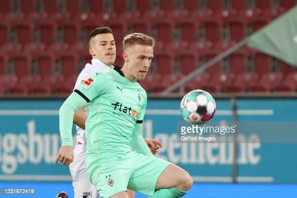 Laszlo Benes of FC Augsburg and Oscar Wendt of Borussia Moenchengladbach battle for the ball during the Bundesliga match between FC Augsburg and...