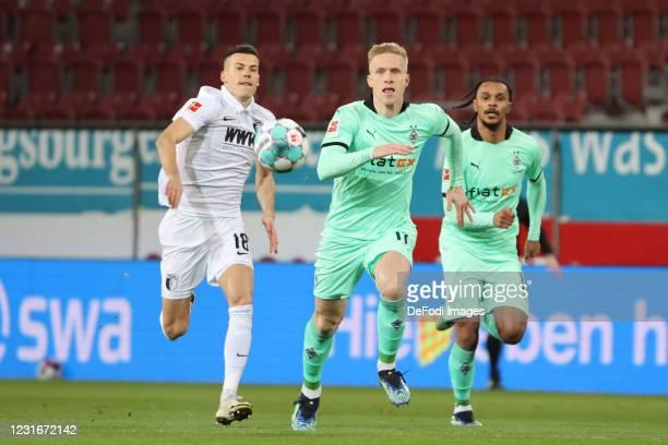 Laszlo Benes of FC Augsburg and Oscar Wendt of Borussia Moenchengladbach ,Zweikampf,duel,im zweikampf,battle for the ball during the Bundesliga match...