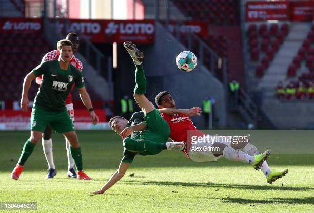 Laszlo Benes of FC Augsburg battles for possession with Leandro Barreiro of 1. FSV Mainz 05 during the Bundesliga match between 1. FSV Mainz 05 and...