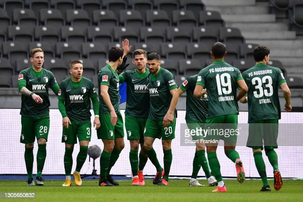 Laszlo Benes of FC Augsburg celebrates with team mates after scoring their side's first goal during the Bundesliga match between Hertha BSC and FC...