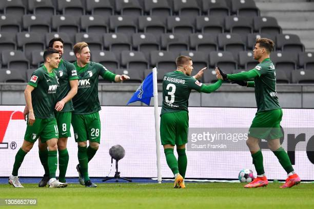 Laszlo Benes of FC Augsburg celebrates with teammates after scoring his team's first goal during the Bundesliga match between Hertha BSC and FC...