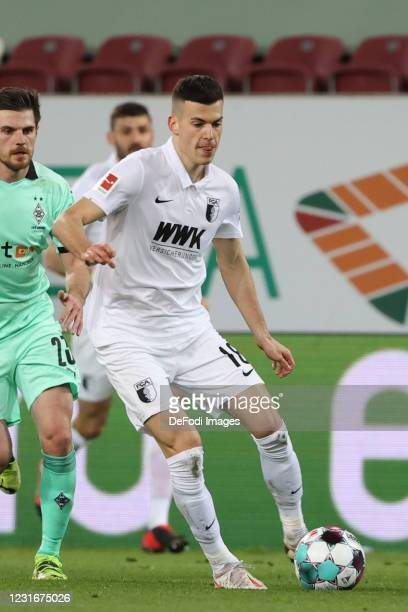 Laszlo Benes of FC Augsburg controls the ball during the Bundesliga match between FC Augsburg and Borussia Moenchengladbach at WWK-Arena on March 12,...