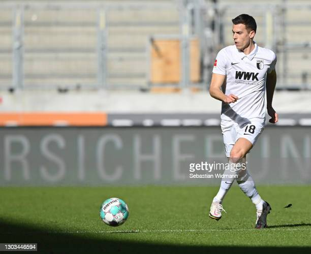 Laszlo Benes of FC Augsburg passes the ball during the Bundesliga match between FC Augsburg and Bayer 04 Leverkusen at WWK-Arena on February 21, 2021...