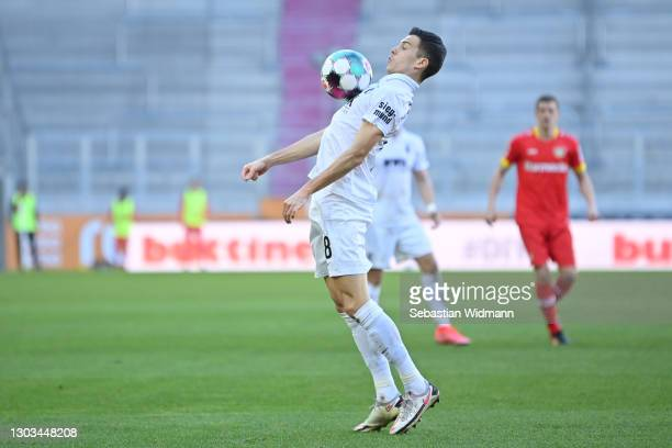 Laszlo Benes of FC Augsburg plays the ball during the Bundesliga match between FC Augsburg and Bayer 04 Leverkusen at WWK-Arena on February 21, 2021...