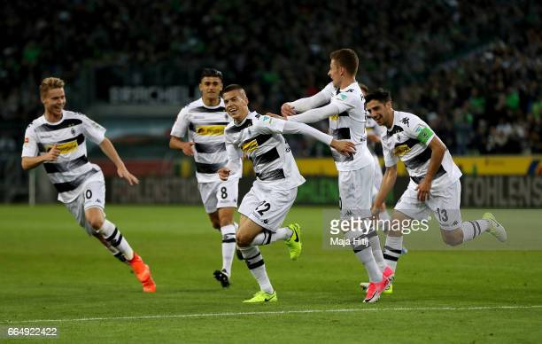 Laszlo Benes of Gladbach celebrates after he scores the opening goal during the Bundesliga match between Borussia Moenchengladbach and Hertha BSC at...