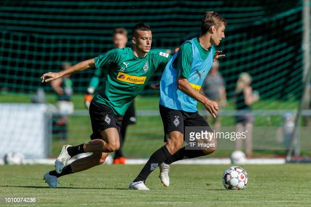 Laszlo Benes of Moenchengladbach and Florian Neuhaus of Moenchengladbach battle for the ball during the Borussia Moenchengladbach training camp on...