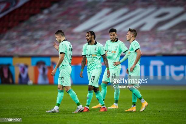 Laszlo Benes, Valentino Lazaro, Ramy Bensebaini and Hannes Wolf of Borussia Moenchengladbach react after the Bundesliga match between Bayer 04...