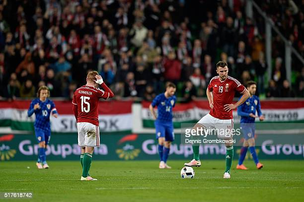 Laszlo Kleinheisler and Tamas Priskin of Hungary look dejected as Mario Mandzukic of Croatia scores the opening goal during the International...