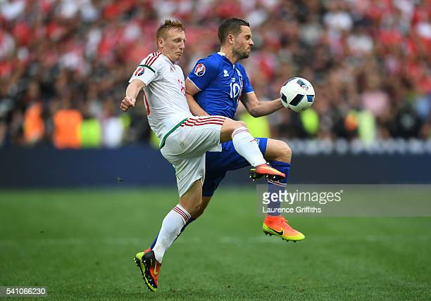 Laszlo Kleinheisler of Hungary and Gylfi Sigurdsson of Iceland compete for the ball during the UEFA EURO 2016 Group F match between Iceland and...
