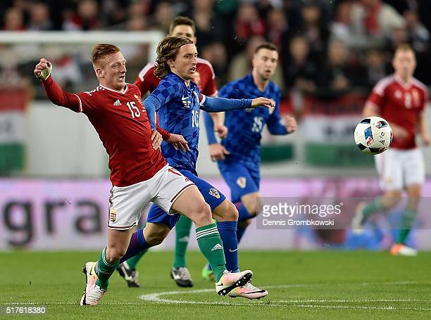 Laszlo Kleinheisler of Hungary and Luka Modric of Croatia battle for the ball during the International Friendly match between Hungary and Croatia at...