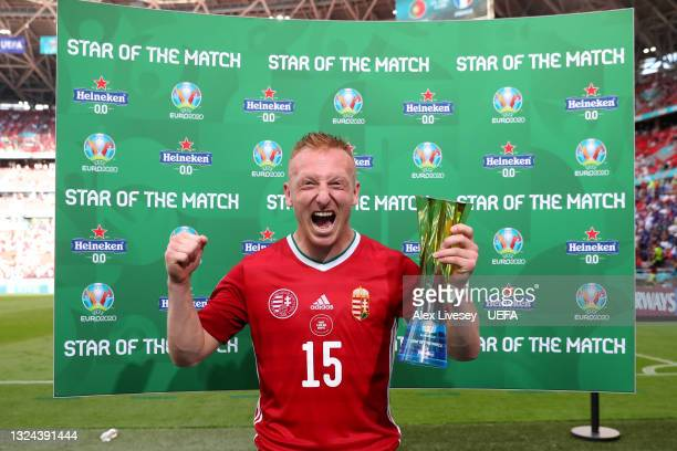 """Laszlo Kleinheisler of Hungary celebrates with their Heineken """"Star of the Match"""" award after the UEFA Euro 2020 Championship Group F match between..."""