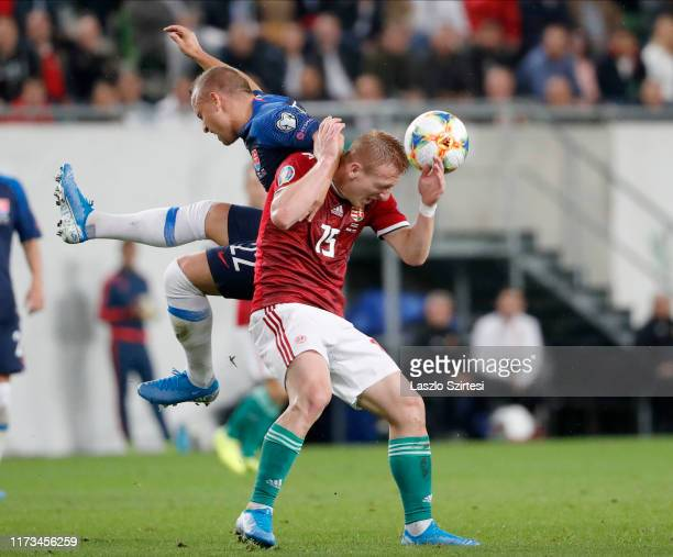 Laszlo Kleinheisler of Hungary fights for the ball with Stanislav Lobotka of Slovakia during the 2020 UEFA European Championships group E qualifying...