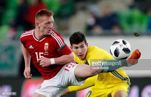 Laszlo Kleinheisler of Hungary wins the ball from Baktiyor Zaynutdinov of Kazakhstan during the International Friendly match between Hungary and...