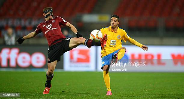 Laszlo Sepsi of Nuernberg and Salim Khelifi of Braunschweig compete for the ball during the Second Bundesliga match between 1 FC Nuernberg and...