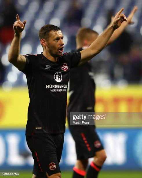 Laszlo Sepsi of Nuernberg celebrates his teams victory at the full time whistle during the Second Bundesliga match between Holstein Kiel and 1 FC...