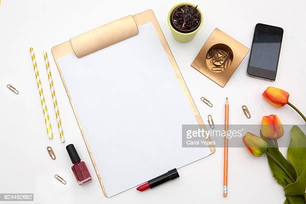lat lay, top view office table desk. feminine desk workspace mock up