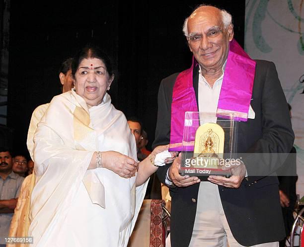 Lata Mangeshkar with Yash Chopra at her birthday concert in Mumbai on Wednesday night