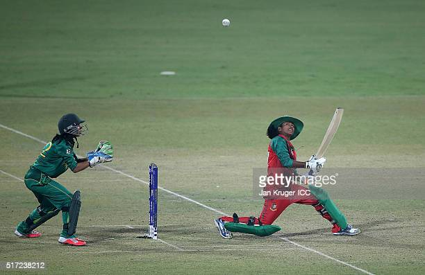 Lata Mondal of Bangladesh attempts to scoop the ball with Sidra Nawaz of Pakistan looking on during the Women's ICC World Twenty20 India 2016 match...