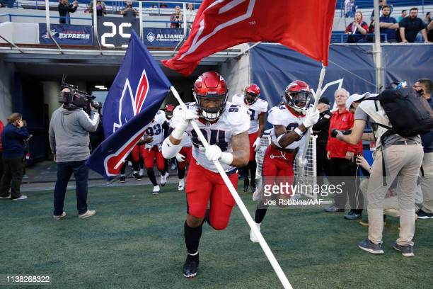 Latarius Brady of the Memphis Express leads the team to the field before the game against the Birmingham Iron at Liberty Bowl Memorial Stadium on...