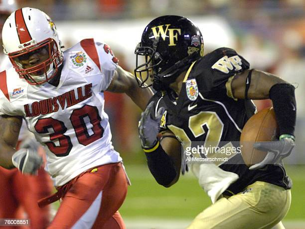Latarrius Thomas of Louisville chases Wake Forest wide receiver Willie Idlettet during the 73rd annual FedEx Orange Bowl between Louisville and Wake...