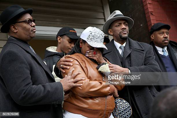LaTarsha Jones center daughter of Bettie Jones is comforted by family and friends during a press conference on Sunday Dec 27 in front of the house...