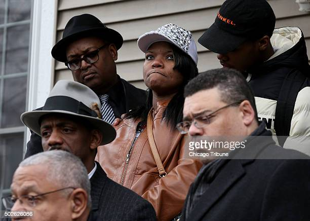 LaTarsha Jones center daughter of Bettie Jones is surrounded by friends and family in front of Jones' home on Sunday Dec 27 2015 Attorneys Larry...