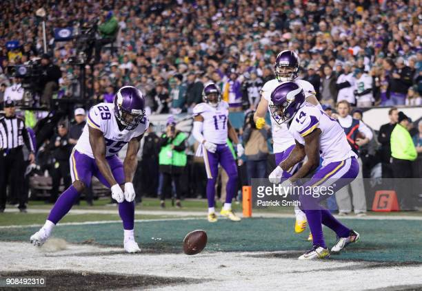 Latavius Murray and Stefon Diggs of the Minnesota Vikings celebrate the first quarter touchdown by Kyle Rudolph against the Philadelphia Eagles in...