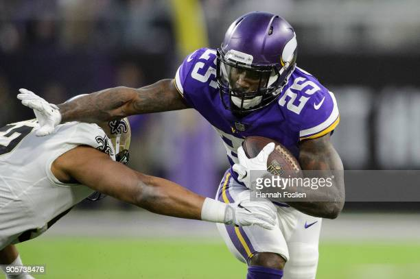Latavius Murray of the Minnesota Vikings carries the ball against Craig Robertson of the New Orleans Saints during the first half of the NFC...