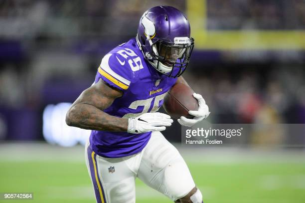 Latavius Murray of the Minnesota Vikings carries the ball against the New Orleans Saints during the second half of the NFC Divisional Playoff game on...