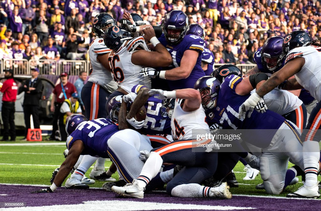 Latavius Murray #25 of the Minnesota Vikings dives into the end zone with the ball to score a touchdown in the second quarter of the game against the Chicago Bears on December 31, 2017 at U.S. Bank Stadium in Minneapolis, Minnesota.