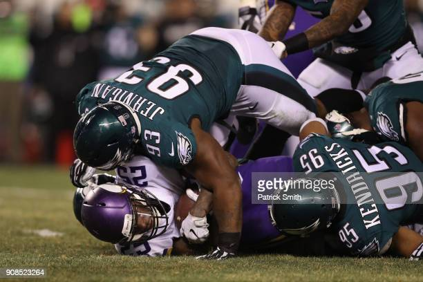Latavius Murray of the Minnesota Vikings is tackled by Timmy Jernigan of the Philadelphia Eagles during the second quarter in the NFC Championship...