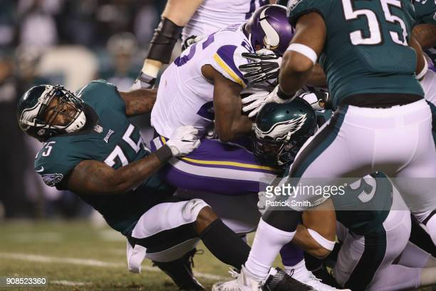 Latavius Murray of the Minnesota Vikings is tackled by Vinny Curry of the Philadelphia Eagles during the second quarter in the NFC Championship game...