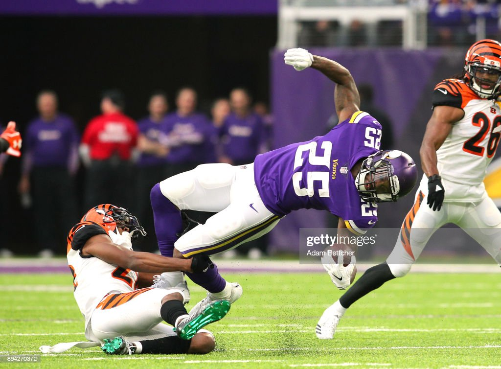 Latavius Murray #25 of the Minnesota Vikings is tackled with the ball by William Jackson #22 of the Cincinnati Bengals in the first quarter of the game on December 17, 2017 at U.S. Bank Stadium in Minneapolis, Minnesota.
