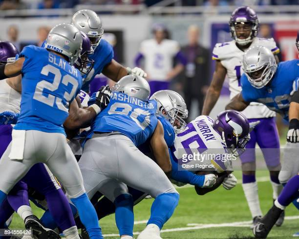 Latavius Murray of the Minnesota Vikings runs with the football against the Detroit Lions during an NFL game at Ford Field on November 23 2016 in...