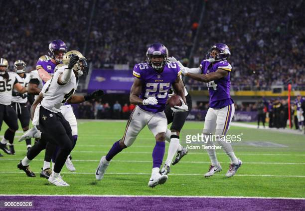 Latavius Murray of the Minnesota Vikings scores a touchdown in the second quarter against the New Orleans Saints in the NFC Divisional Playoff game...