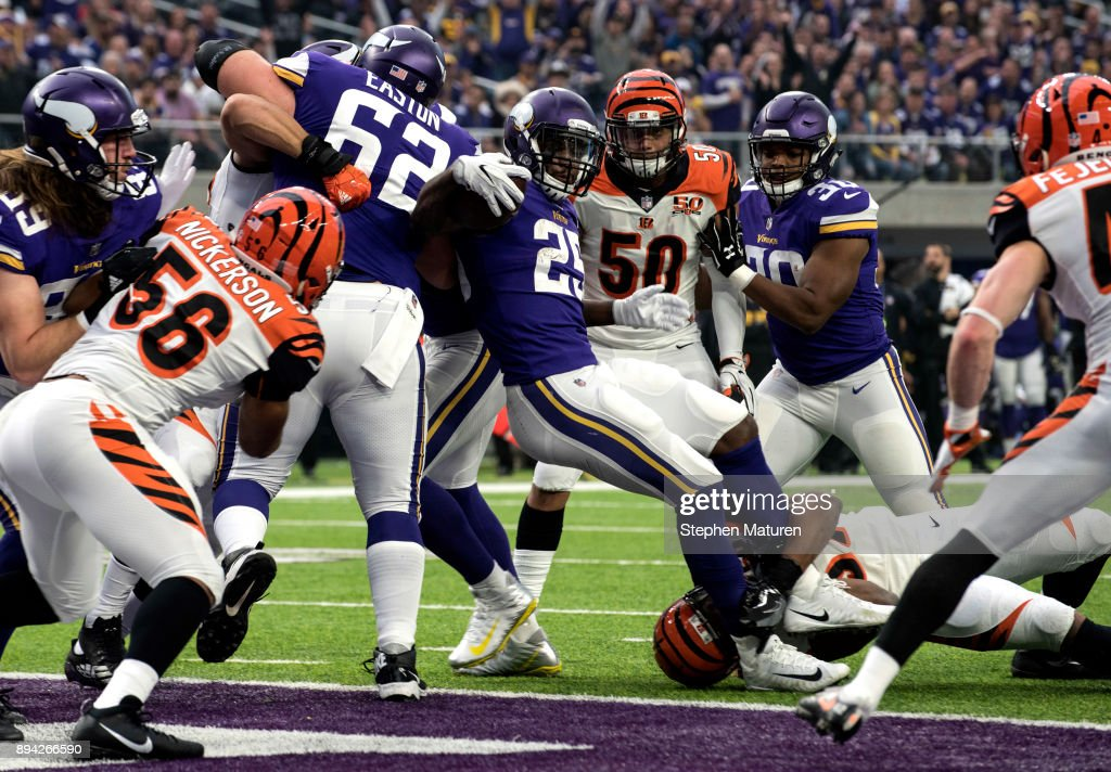 Latavius Murray #25 of the Minnesota Vikings spins into the end zone with the ball for a touchdown in the first quarter of the game against the Cincinnati Bengals on December 17, 2017 at U.S. Bank Stadium in Minneapolis, Minnesota.