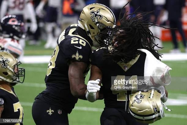 Latavius Murray of the New Orleans Saints celebrates with Alvin Kamara after scoring a six yard touchdown against the Chicago Bears during the third...
