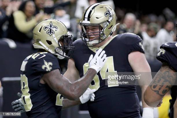 Latavius Murray of the New Orleans Saints celebrates with Kiko Alonso after scoring a 26 yard touchdown against the Carolina Panthers during the...