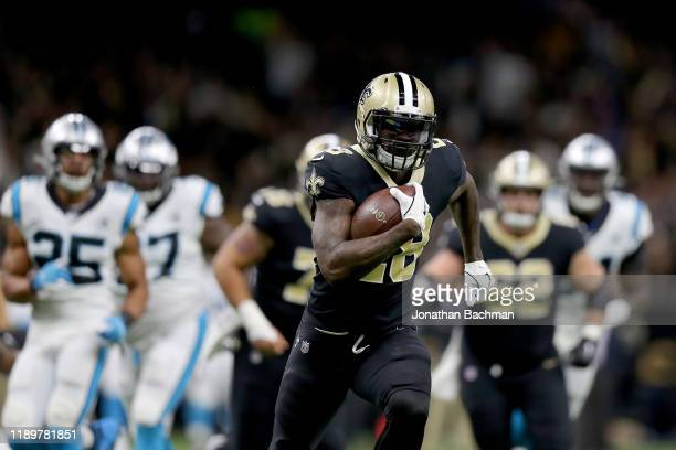 Latavius Murray of the New Orleans Saints scores a 26 yard touchdown against the Carolina Panthers during the first quarter in the game at Mercedes...
