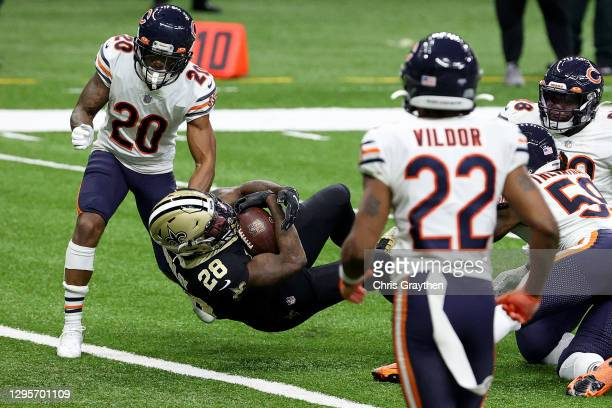 Latavius Murray of the New Orleans Saints scores a six yard touchdown against the Chicago Bears during the third quarter in the NFC Wild Card Playoff...
