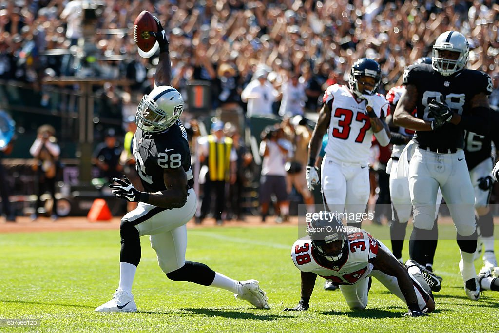 Latavius Murray #28 of the Oakland Raiders celebrates after a 1-yard touchdown run during their NFL game against the Atlanta Falcons at Oakland-Alameda County Coliseum on September 18, 2016 in Oakland, California.