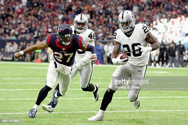Latavius Murray of the Oakland Raiders eludes Quintin Demps of the Houston Texans for a touchdown in the AFC Wild Card game at NRG Stadium on January...